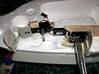Name: fuselage_17.jpg Views: 133 Size: 150.2 KB Description: Servos bolted on their baseplates, first attempt at servoless geardoor operation. Endplates for geardoors glued at right angles to the door, door shortened but not yet bowed.