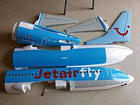 Name: b737 vinyl_8.jpg Views: 122 Size: 142.3 KB Description: The tail feathers removed as for transport or storage, aft tail halves already glued together and fully decorated, forward fuselage halves flat on the surface to facilitate application of vinyl and final decorations.