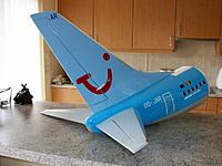 Name: b737 vinyl_11.jpg Views: 102 Size: 152.9 KB Description: Fully assembled and decorated tail, no visible signs that the 3 feathers even can be separated in a matter of seconds.