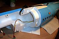 Name: b737 vinyl_16.jpg Views: 105 Size: 129.9 KB Description: Holding the assembled tail firmly against one of the fuselage halves during gluing, toothpicks preventing any accidental rotation.