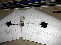 Name: fuselage_40.jpg Views: 112 Size: 154.0 KB Description: To the left: the system as suggested by Windrider. To the right: servo physically reversed in one of the tails (before filling up the leftover gap with foam). Limited space available for electrical connections in cavity between the tails.