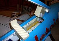 Name: ready for maiden_3.jpg Views: 95 Size: 131.0 KB Description: The battery in the most forward position capped by a ventilated immobilizer that also prevents it from moving backwards, battery latch with yellow foam block to keep both batteries on their respective side of the fuselage.