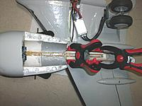 Name: repair summer 15_3.jpg Views: 97 Size: 153.9 KB Description: Keeping everything tightly in place with clamps for 24 hours. Wood temporary wood along the clamps to distribute the force and not squeeze the foam too much.