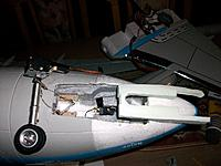 Name: repair summer 15_8.jpg Views: 98 Size: 145.8 KB Description: The new nosegear with the old steering mechanism, plus the foam part fabricated to diminish the wide gap left by the geardoors and mechanism.