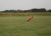Name: 13.jpg Views: 29 Size: 161.2 KB Description: About to nose over during the landing rollout, more up elevator travel will probably reduce this tendency on grass strips.