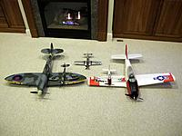 Name: IMG_3122.jpg Views: 97 Size: 152.4 KB Description: Parkzone warbirds by the fireplace.  Two Spitfires, two T-28's, and a P-51D.