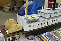 Name: MJ0_0011.jpg Views: 243 Size: 195.0 KB Description: The lifeboat is ready for white paint and making a canvas cover. The small working blocks I found are the exact size needed and will look good on the brass davits when installed
