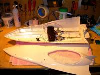 Name: Topless.jpg Views: 532 Size: 67.2 KB Description: With the screws pulled, the top came off after a little bit of work prying apart the cheap glue they applied to the rear to keep the stern joint area 'tight'.