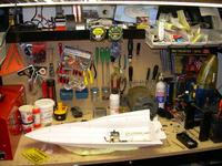 Name: 22NewWorkspace.jpg Views: 431 Size: 87.3 KB Description: Ah, the new old new workbench... hey, that's my boat back on it kinda where I left off! :D