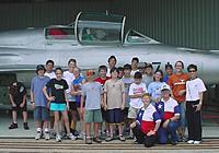 Name: Scouts and Mig 21.jpg Views: 34 Size: 56.1 KB Description: Another group of kids touring the Mig 21s  during one of my Aviation Day Camps at Ellington Field.  There were two Might 21s. The two seats trainer and a single seat fighter.  Much simpler than our jet fighters, they are pretty impressive aircraft.