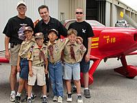 Name: Scouts and T-18.jpg Views: 40 Size: 142.0 KB Description: Many of the students attending the Aviation Day Camp were Boy Scouts earning their Aviation Merit Badge.  I am a Merit Badge Counselor for the Scouts.  I'm the 'big kid' in the middle in the back with two other 'big kids'!