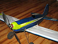 Name: 7-7-10 009.jpg Views: 440 Size: 115.1 KB Description: Here she is in current garb.  I also have progressed in the heat shrunk water/pop bottle cowls and started coating the fuse with wbpu and coffee filters.  Also note I painted the wing top surface white!