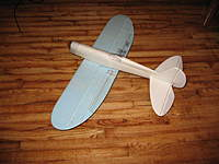 """Name: 7-7-10 002.jpg Views: 469 Size: 105.1 KB Description: Latest and still work in progress is a 40"""" span 30's racer using the same Pete planform, just scaled up. this guy has Readiboard dollar store foam fuselage rolled much like the Mike.  Readiboard rolls better than FFF! The wing is PBlll and is a kfm3."""