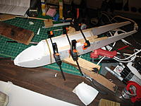 Name: ost build 011.jpg Views: 377 Size: 128.5 KB Description: Here's the glue up of fuse top. It's previously been rolled on edges and trimmed to match the fuse sides.  Glue the aft tip of fuse together, before gluing the aft fuse top on.
