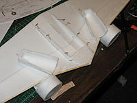 Name: ost build 022.jpg Views: 341 Size: 80.6 KB Description: Bottom of fuse cut and glued to wing bottom.  If the main bottom is glued to fuse, it will be easier to glue to wing instead of the thin strips shown.  Also note nacelles.
