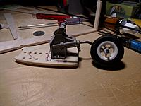 Name: IMG_20130307_001649.jpg Views: 59 Size: 154.8 KB Description: i changed on of the balsa fuselage rib to a ply and drilled some holes for the controll rods...  then screwed the retracts on it