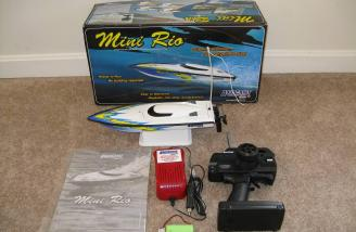 The complete RTR package contents, including complete boat, stand, charger, battery and instructions.