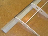 Name: Pdrm1270.jpg Views: 1337 Size: 76.1 KB Description: Glue the tube to the rib on each end of the wing.