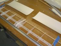 Name: Pdrm1278.jpg Views: 1345 Size: 97.1 KB Description: After the glue has dried enough. Run a bead of thick CA along the top of the ribs, the spar, and the front leading edge tube, on one side of the wing.