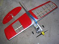 Name: RingmasterJr Wing Covering Removed.jpg Views: 51 Size: 92.5 KB Description: Ringmaster needing repairs, missing rudder, broken stabilizer, broken wing ribs.