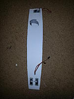 Name: 20150221_093221.jpg Views: 307 Size: 658.4 KB Description: Servo slots cut and servos glued. Velcro strap for holding the battery in place