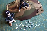 Name: HL King Tiger Build 017.jpg Views: 119 Size: 557.6 KB Description: Mako and Hana look over cut styrene and foam bits to make commander view ports