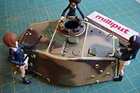Name: HL King Tiger Build 036.jpg Views: 138 Size: 552.0 KB Description: The girls inspect the weld work.  Track hangers and lift hooks added, so many scale nice details on this toy