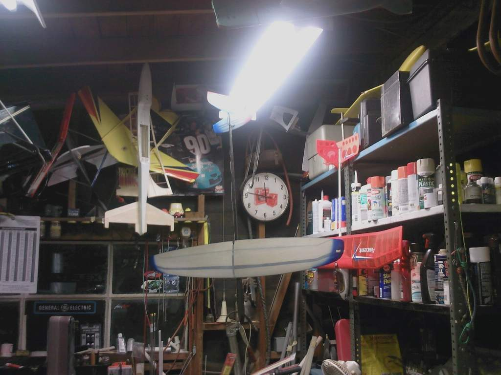 Name: shop pic 2.jpg Views: 265 Size: 74.0 KB Description: Lets start left to right with the atmopod, a wing and tail from a Hobby Lobby V something, Bob Martin SR7 fuse, Rad 2 DLG, E-flite Ascent on the top shelf is a Bob Martin Coyote.
