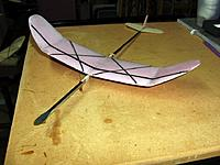 Name: tustin standard cat pink foam 2.JPG Views: 22 Size: 148.6 KB Description: The best of my composite winged indoor catapult gliders, built for my attempts in 2012 to break the category 4 record at the Tustin blimp hangar.  This one has a 12 inch span, flew at about 6.5 grams: foamular 250 core with .75 oz glass.