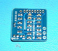 Name: DSCF0333a.JPG Views: 127 Size: 196.6 KB Description: Seeing if 0402 parts fit on 0603 pads. All these parts are 0402 except the 2 top center caps and 2 resistors. I still need more work on SMD skills.