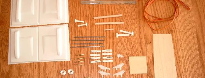 The kit has a complete assortment of necessary parts.  Note the servo wire included for making your own extensions.