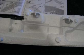 The 2-piece wing screw retainer plates have been glued in place.