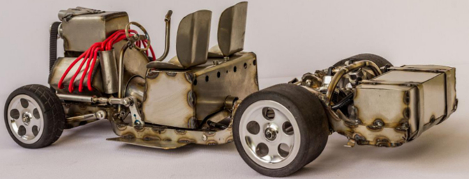 Here is the chassis with the body removed to reveal the faux engine, seating and rear battery box.
