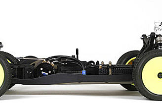 This buggy features a centralized forward motor mount and a sealed 3-belt drivetrain with modular covers.