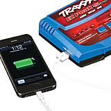 It conveniently charges mobile electronics devices as well. Very useful when track-side.