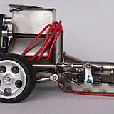 The steering servo is mounted in the floor of the driver's side and uses a turnbuckle link to manipulate the angle of the front tires.