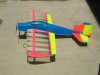 Name: MF2.jpg Views: 652 Size: 78.2 KB Description: Plywood battery hold down stick was modified. 4/40 R/C car ballstud used to join wings. ballstud used to hold down (cut) battery stick with butyl rubber o-ring from a prop saver. Works GREAT.
