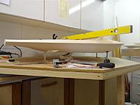 Name: DSC01230.jpg Views: 198 Size: 77.6 KB Description: Setting the height of the main gear mounting plate, note the dummy balsa leg. Plane set level both in pitch and roll by moving the plates vertically.
