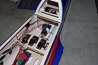 Name: MXS-R build final pics 005.jpg Views: 214 Size: 202.6 KB Description: reciever behind servo tray and regulator under turtle deck. 2 cell lipo direct to switch, then direct to spc port on reciever and from switch spliced off second wire through regulator for servos through battery port on reciever.