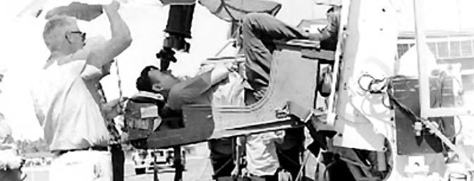 Maynard Hill setting a world altitude record for model aircraft using a binocular sighting device.  Photo courtesy the Academy of Model Aeronautics.
