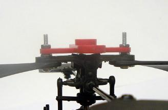 Side view showing the bolts and nuts used to hold the servo horn to the head.