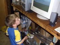 Name: CIMG0925.jpg Views: 1520 Size: 88.5 KB Description: My son, Raymond, Jedi Warrior, plays with the RealFlight display at Mike's Models