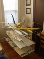 Name: PlaneRack.jpg Views: 275 Size: 45.9 KB Description: After strongly suggesting that I get my new planes off the dinning room table I got the last laugh on the girlfriend by using her IKEA drying rack as a plane holder.