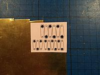 Name: Billede 10-01-2019 20.16.45.jpg Views: 25 Size: 219.5 KB Description: Starting out as always by gluing a template on the brass plate. Then the holes a drilled while it is still possible to holde on to the brass sheet.
