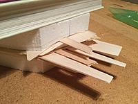 Name: Billede 13-01-2019 22.05.43.jpg Views: 33 Size: 196.5 KB Description: Since the wing is elliptic I had to sand off a bit of the foam core before sheeting. That left a void between the core and the cradles. Tried to fix it by stuffing it with long pieces of balsa. Not sure if it worked ... and no way to check for lifting.