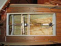 Name: Ram Schooner aft mid ship hatch showing sail arm and aft false keel tube..jpg Views: 280 Size: 301.8 KB Description: aft hatch showing rudder control