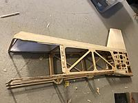Name: 20190511_170316121_iOS.jpg Views: 16 Size: 2.41 MB Description: Cleaning rear fuselage wood cuts. I want to attach new side panels as cleanly as possible.