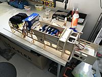 Name: 20190618_091748260_iOS.jpg Views: 9 Size: 2.32 MB Description: Second step of the front fuse assembly: the top panel and top formers are being glued. I used plenty of weights to ensure that the fuse will be straight.