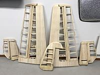 Name: 20190627_184955696_iOS.jpg Views: 11 Size: 2.09 MB Description: Wings & tail surfaces sanded & ready for covering.