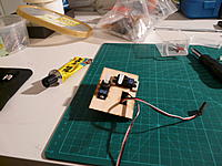Name: 6-tailservos.jpg Views: 169 Size: 196.7 KB Description: Tail servos attached to plywood mount. I raised another servo to ensure that control rods won't bind together.